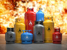 Gas Tanks Or Bottles On Explosive Flame And Fire Background. Danger Of Using Gas Concept,