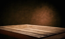 Background Dark Brown With Straight Light And Worn Old Wooden Table