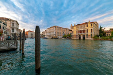 Beautiful Perspective Panorama Of The Grand Canal During A Summer Day With Blue Sky And Clouds. In The Background The Palazzo Grassi In The Venetian Lagoon, Venice, Italy.