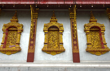 Temple Wat Nong Sikhounmuang, Luang Prabang, Laos With Gilded Carvings Of Mythical Creatures