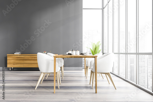 Obraz Grey dining room with wooden furniture and commode near window - fototapety do salonu
