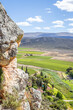 canvas print picture - View of Montagu Springs valley and Mountain range with large red rocky outcrops and lush green vegetation, Montagu Springs, Cape Town, South Africa