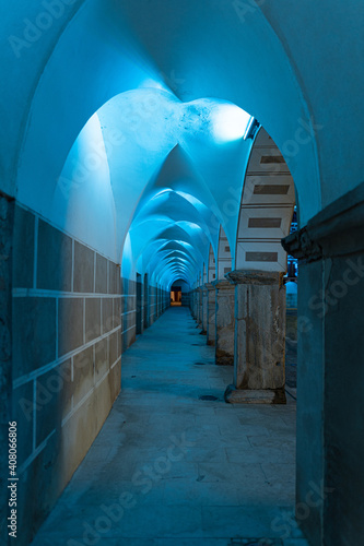 Fototapeta Photo of different colonnades with an Arabic architecture style and illuminated