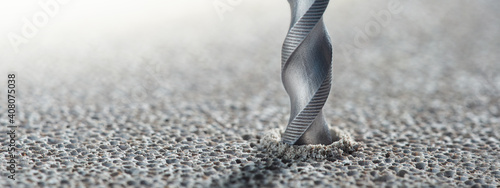 Obraz metal drill bit make holes in concrete wall on industrial drilling machine with shavings. Metal work industry - fototapety do salonu