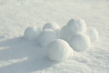 Pile Of Perfect Round Snowballs On Snow Outdoors