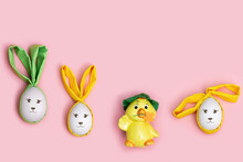 Easter Bunny Rabbit And Cute Little Chicken On Pink Background. Holiday Eggs Decorated Fabric Ears, Funny Easter Concept.