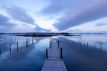 Beautiful Seascape With Bridge, Rocky Islands, And Magenta Clouds In A Symmetrical Composition On An Early Morning In Sweden