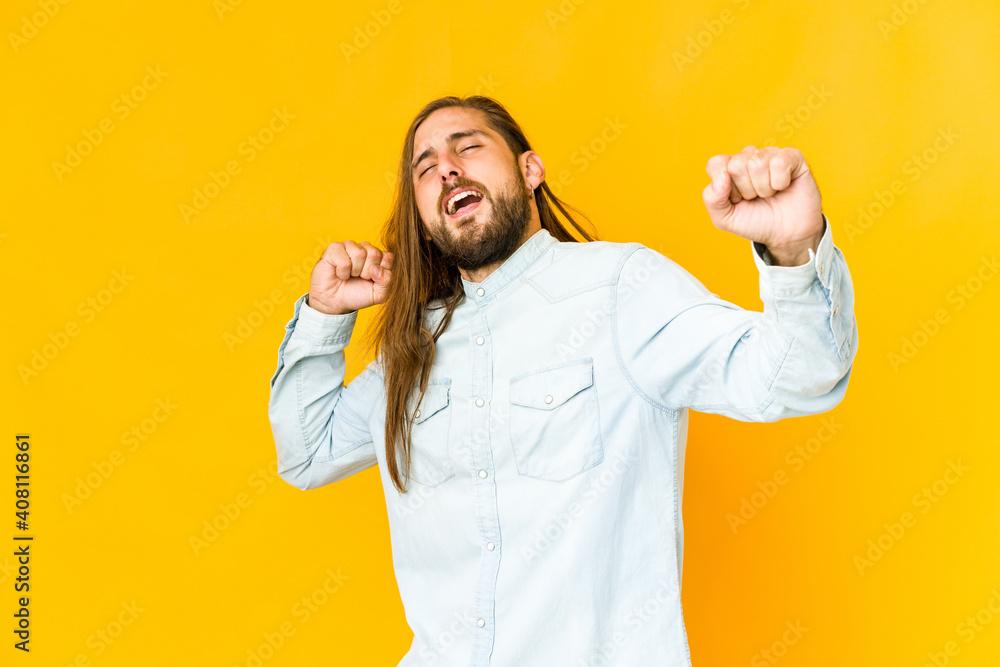 Fototapeta Young man with long hair look dancing and having fun.