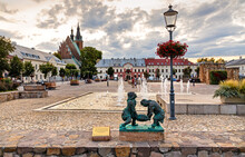 Panoramic View Of Olkusz Market Square With St. Andrew Basilica And Statue Of Historic Miners In Beskidy Mountain Region Of Lesser Poland