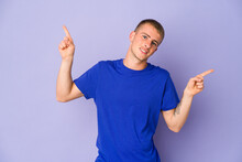 Young Caucasian Handsome Man Pointing To Different Copy Spaces, Choosing One Of Them, Showing With Finger.