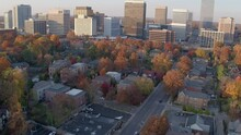 Aerial View Of Downtown Clayton In St. Louis, Missouri On A Beautiful Autumn Day With Trees At Peak Color And Cars Going Up And Down The Street.