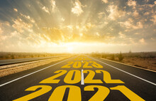 The Word 2022 Written On Highway Road In The Middle Of Empty Asphalt Road At Golden Sunrise