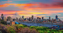 Nelson Mandela Bridge And Johannesburg City At Sunset