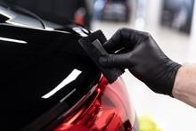 Car Detailing Studio Worker Applying Ceramic Coating On Car Varnish