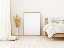 Vertical Frame Mockup Standing On Floor In Boho Bedroom Interior With Wooden Bed, Beige Blanket, Cushion With Tassels, Dried Pampas Grass On White Wall Background. 3d Rendering, 3d Illustration