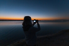 Silhouette Of A Person Watching The Sunset