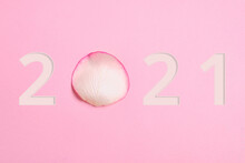 Rose Petal On Pink Background With Year 2021