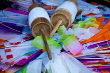 Colored Paper Kites And Latai (Knitting Reel).