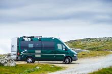 Camper Van In Mountains On Roadside, Norway