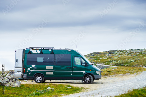 Canvas Camper van in mountains on roadside, Norway