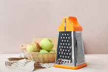 Metal Grater And Apples On Table