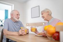 Senior Couple Having Breakfast And Looking Peaceful