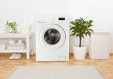Modern Washing Machine, Towels And Related Objects In Laundry Room