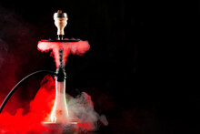 Smoking Hookah On Black Background With Color Fog