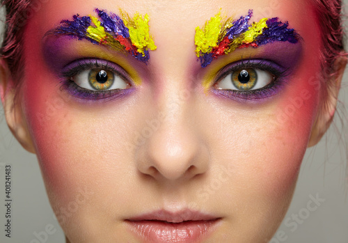 Photo Close-up female portrait with unusual face art make-up and freckles