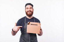 Photo Of Happy Chef Man Pointing At Delivery Food Box.