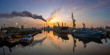 Panorama Of The Industrial Landscape - A Smoking Power Plant, A Bulk Cargo Ship In A Shipyard, A Scrap Recycling Station