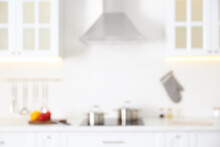 Blurred View Of Modern Kitchen Interior With White Furniture