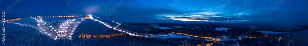 Fototapeta Panoramic cloudy sunset over the ski slopes of Levi, Kittilä, Finland.