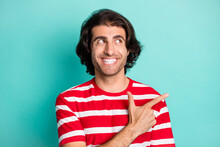 Portrait Of Attractive Cheerful Guy Demonstrating Copy Space Empty Blank Place Ad Isolated Over Bright Green Turquoise Color Background