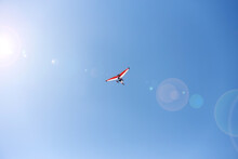 White-red Hang Glider And Sun Glare.