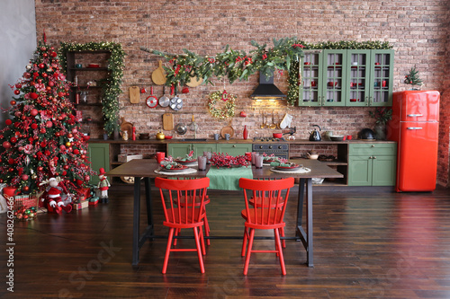 green kitchen interior with red fridge on brick wall background Wallpaper Mural