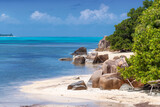 Fototapeta Kawa jest smaczna - Beautiful rocks on exotic Sunny beach and coconut palms on Seychelles islands. Summer vacation and tropical beach concept.