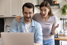 Great Thing Excited Young Husband And Wife Feeling Euphoria Triumph Reading Email From Bank Getting Loan Approval. Astonished Couple Winning Big Money Reward In Lottery Amazed With Unexpected Luck