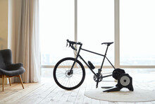 Stationery Exercise Bike In Apartment With Wooden Floor