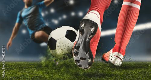 Fotografia Soccer player making sliding tackle