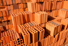 Stacks Of Red And Brown Clay Bricks And Blocks For General Construction And Reform