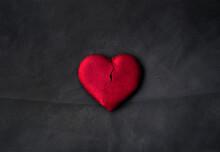 A Semi-broken Heart-shaped Cookie. Dark Background