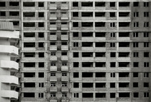 Black And White Image Of An Unfinished  Multistory Building.