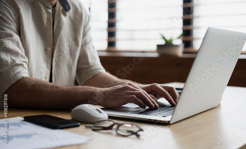 Obraz Man hands typing on computer keyboard closeup, businessman or student using laptop at home, online learning, internet marketing, working from home, office workplace freelance concept - fototapety do salonu