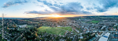 Aerial panoramic view of English market town at sunset
