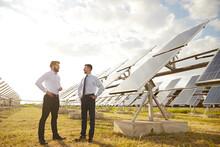 Businessmen Talking On Solar Power Plant
