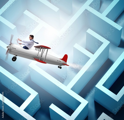 Businessman escaping from maze on airplane Wall mural