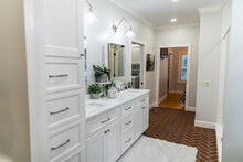 Large White Renovated Master Bathroom With Red Brick Floors