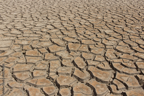 Leinwand Poster Arid dry cracked soil - Desertification