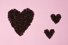 Handcrafted Arrangement Of Coffee Beans Shaped To Resemble A Heart, Symbol Of Love To Commemorate Valentine's Day. Blend Of Coffee Beans And Symbol Of Love For The Background Concept.